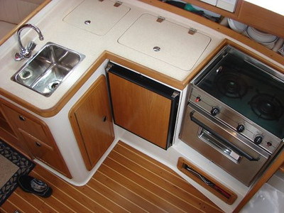 Galley with Top and Front Loading Refrigerator, Two Buner Stove and Oven