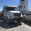 Trucks on board barge Niska I.
