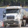 Transport truck and trailer backing onto barge Niska I.