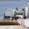 Barge Niska I lowering its ramp to unload.