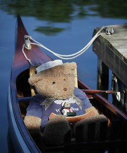A teddy bear waits for a ride in a 1913 B.N.Morris canoe owned by Jerry Welch at the 34th annual Antique and Classic Boat show at the Olde Harbor Inn and Hook Line and Drinkers on Saturday June 27, 2009, in Coventry Township, Ohio.  Photo By Lew Stamp, PhotoStamp@sbcglobal.net