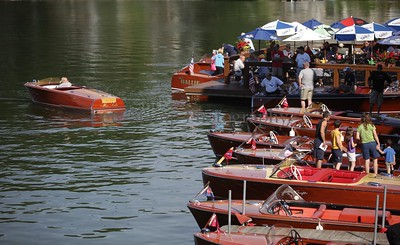 Boats line up at the 34th annual Antique and Classic Boat show at the Olde Harbor Inn and Hook Line and Drinkers on Saturday June 27, 2009, in Coventry Township, Ohio.  Photo By Lew Stamp, PhotoStamp@sbcglobal.net