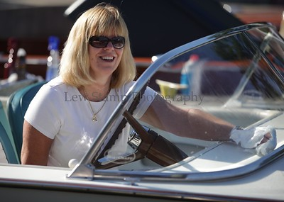 Karen Staggs polishes the 1964 Chris Craft Super Sport with a powered by a 327 Corvette engine at the 34th annual Antique and Classic Boat show at the Olde Harbor Inn and Hook Line and Drinkers on Saturday June 27, 2009, in Coventry Township, Ohio.  Photo By Lew Stamp, PhotoStamp@sbcglobal.net