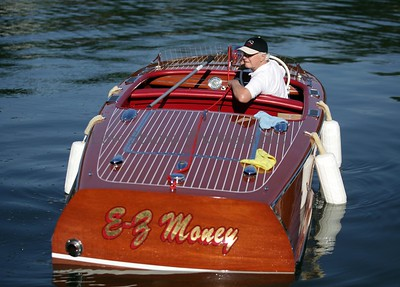 "Joe Nemes of Akron docks his 1948 Chris Craft Deluxe ""EZ Money"" at the 34th annual Antique and Classic Boat show at the Olde Harbor Inn and Hook Line and Drinkers on Saturday June 27, 2009, in Coventry Township, Ohio.  Photo By Lew Stamp, PhotoStamp@sbcglobal.net"