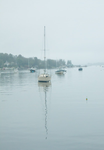 reflections on a sailboat and mast in harbor waters, Boothbay Harbor Maine, Linekin Bay