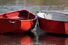 Red tender dinghies nudging together, Sebasco Harbor, Round Cove, Phippsburg Maine. This would make a cute card!