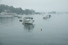 Lobster boats in harbor shrouded in fog, Boothbay Harbor, Linekin Bay, Maine
