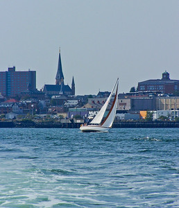 Portland Harbor, Casco Bay, Maine sailing with City of Portland skyline in the background, a nice mix of the urban and recreational