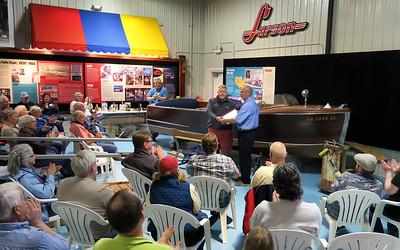 Bave Bortner presenting Bob Speltz notebooks to Bruce Olson