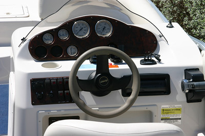 Hurricane Deck Boat 198R Console. Mountings for fish finder, GPS, and compass. Radio with removable face.