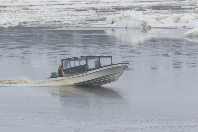 Taxi boat comes from Moose Factory to pick up people and potato chips.