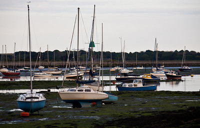 Boats wait for the tide to return on the Chichester Harbour.