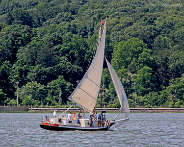 The Oyster boat Christeen under sail on a windy day in Oyster Bay Harbor.