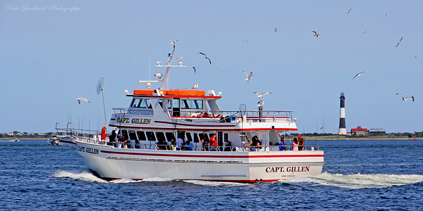 The Captain Gillen party fishing boat. Photo taken from Captree State Park on Long Island,NY.  The Fire Island Lighthouse sits in the background.