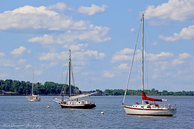 The Christeen Oyster boat with two other sailboats anchored in Oyster Bay Harbor.