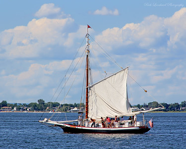 The Christeen Oyster Boat raising it's sail in Oyster Bay Harbor.
