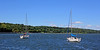 Two sailboats anchored in Oyster Bay Harbor.