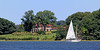 Sailboat by mansion on Oyster Bay Harbor.