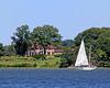 Sailboat near mansion on Oyster Bay Harbor