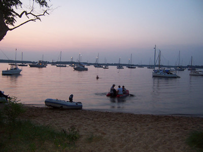 Sunset Saturday night, 2006 Annual Regatta at Conquest.  The boats anchored out are the Magothy River fleet, which raced over from Annapolis.