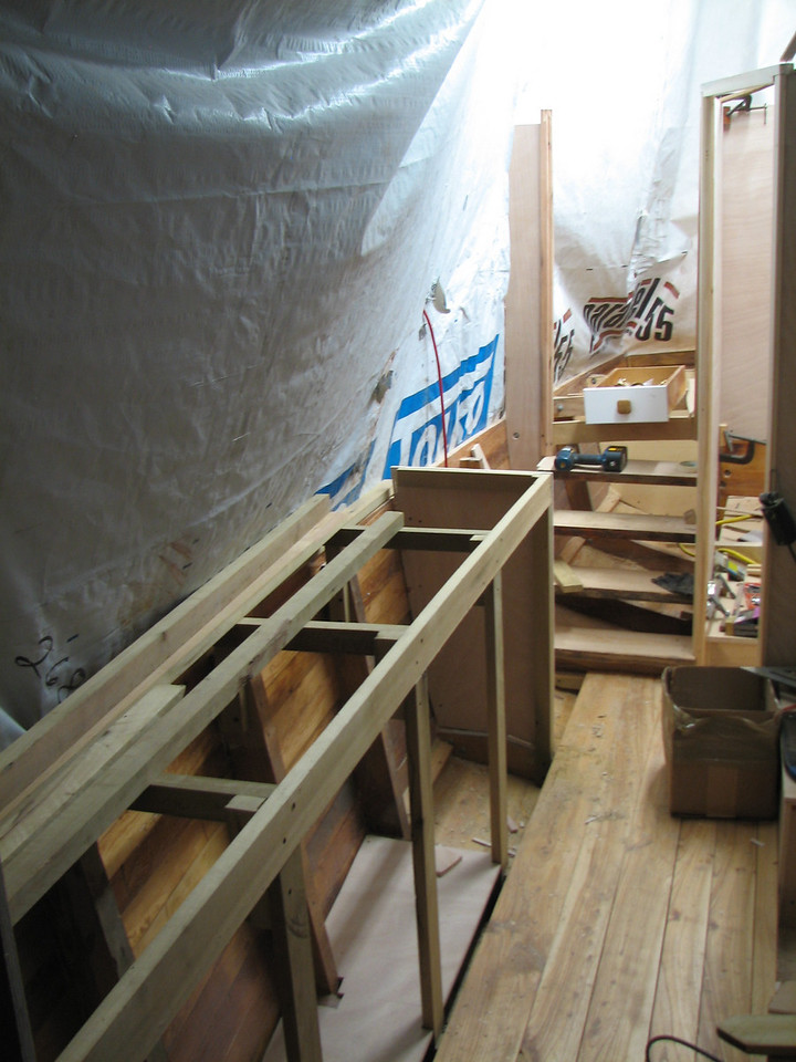This picture shows the framing for the Starboard cabinets, and the elm flooring.