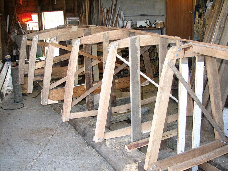 """Visible are frames # 4, 6, 8, 10, 12, and 14.  Number 30 will be the transom, or stern end of the boat.  When all frames are in place and it is all """"faired"""" up, the planking will begin.  Then the hull will be turned over for work on the inside to begin."""