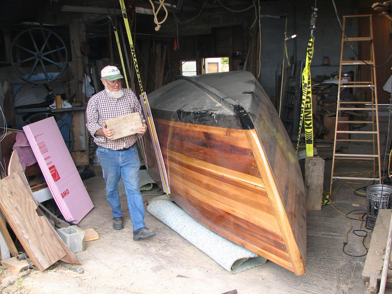 Lynn lugs a 8x8 block to raise the jack.  The boat still needs a lot of raising to give it space to roll over.