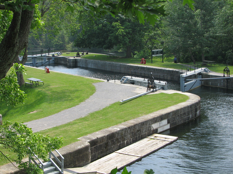 """The Rideau Canal in Canada runs 201 km from Kingston (in the Thousand Islands region of Lake Ontario) to Ottawa.  <br /> <br /> These locks at Jones Falls now serve primarily recreation boats.  The Rideau Canal has been recognized by UNESCO as a World Heritage Site.  Learn more at:<br /> <br />  <a href=""""http://whc.unesco.org/en/list/1221"""">http://whc.unesco.org/en/list/1221</a>"""