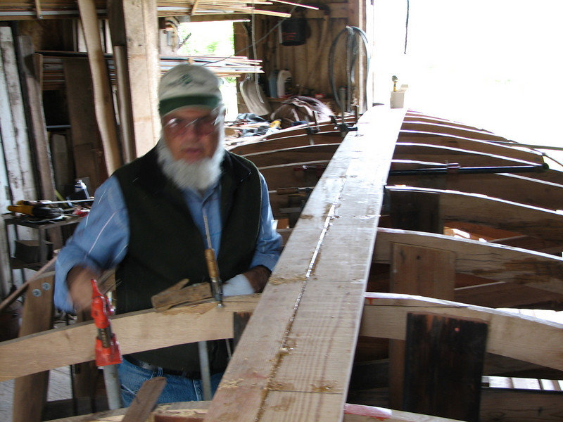 The planking will be glued to each other but not to the framing.  Long stainless steel screws fasten each plank to the frame, and a screw is driven through the width of the plank midway between each frame.