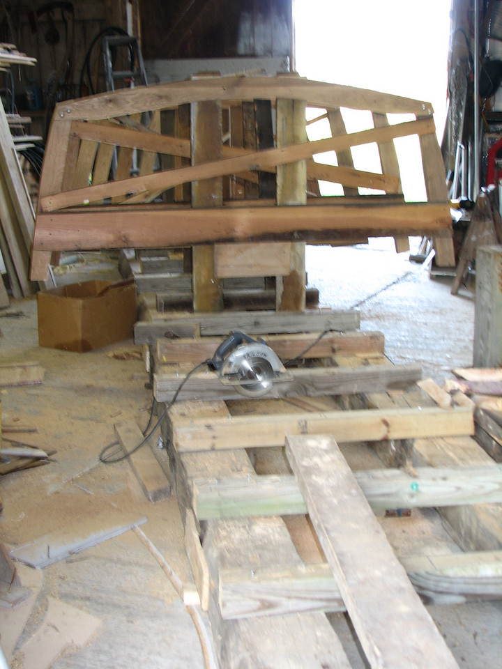 The frames are constructed and placed nearly halfway to the back of the boat.  The strongback consists of heavy beams with well squared cross sections at every two feet.