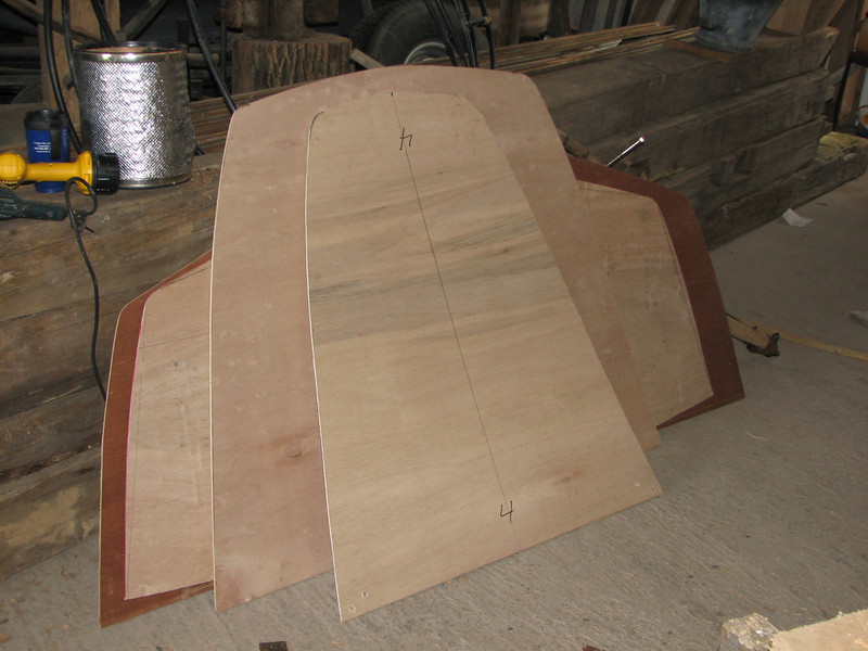 """These luan frame patterns indicate the cross section of the boat hull every two feet.<br /> <br /> Why did Lynn select this hull pattern?  This boat can easily be built by a home boat builder.  It requires no sharp bends in the planks and thus avoids the need for steaming the planks.  <br /> <br /> The plans come from a book of Herreshoff plans.  L Francis and his kin are famous wooden yacht builders from Bristol RI.  He named this hull the """"Meadow Lark.""""  Although it was intended to be a sailboat, it is an appropriate name, it seems, for a canal boat."""