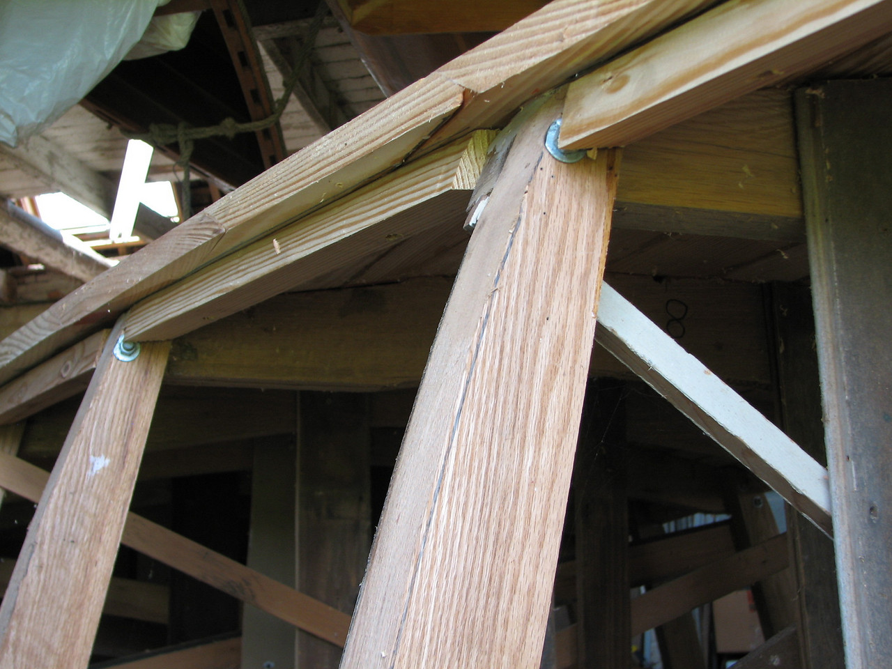 The chine log sections are fitted between the frames where the bottom planking and side planking join (the chine).  The cedar side plank is screwed and glued to the chine log for a secure tight fit.