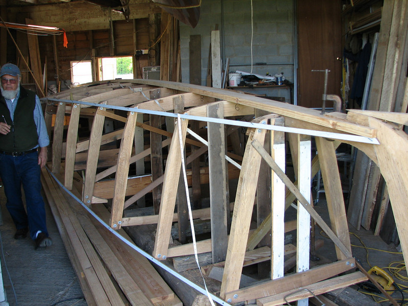 """But enough dreaming.  Back to boat building...<br /> <br /> <br /> The lines of the boat begin to appear.  Battens are used to """"fair"""" the frames so there are no bulges or dips.  For this part, one must rely on a good eye rather than a ruler."""