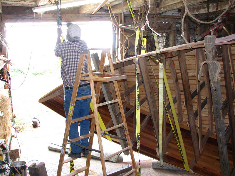 """A """"come-along"""" (racheting cable hook) tightens the front strap to lift the bow a bit higher."""