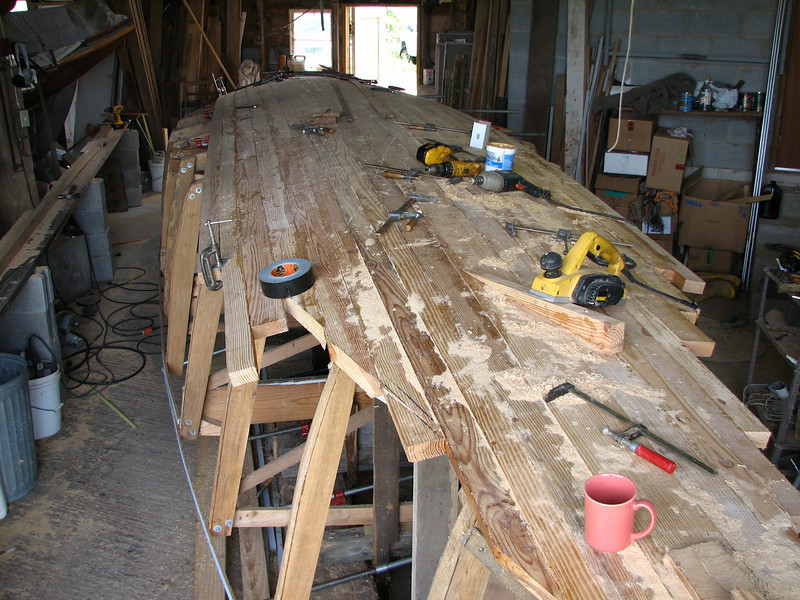 The last few pine planks are installed and cut to shape.