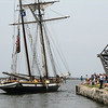 "The Lynx pushes off for a ""sail-away.""  Funny how it managed to get out to the breakwall with no sail?!  Elaine waited forever to see it ""under sail."" The Lynx is a replica of a Revelotionary war era ""Privateer.""  This boat sails out of Boston."