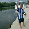 Douglas fish- At Herkimer NY there is a floating dock in front of a little shopping mall, complete with a pontoon cruise boat service. While we were tied up there Douglas took a fishing pole, made one cast and hooked this very nice little bass. A few minutes later he caught another one, and that night we grilled them for dinner.
