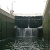 Lock 3 Falls; Lock O-3 at Fulton NY is a little leaky at the moment, with water cascading over the sill. From the bottom of the lock to the canal level up stream is 40', but with a 15' depth in the lock you only have to be lifted 25' to be on your way upstream.