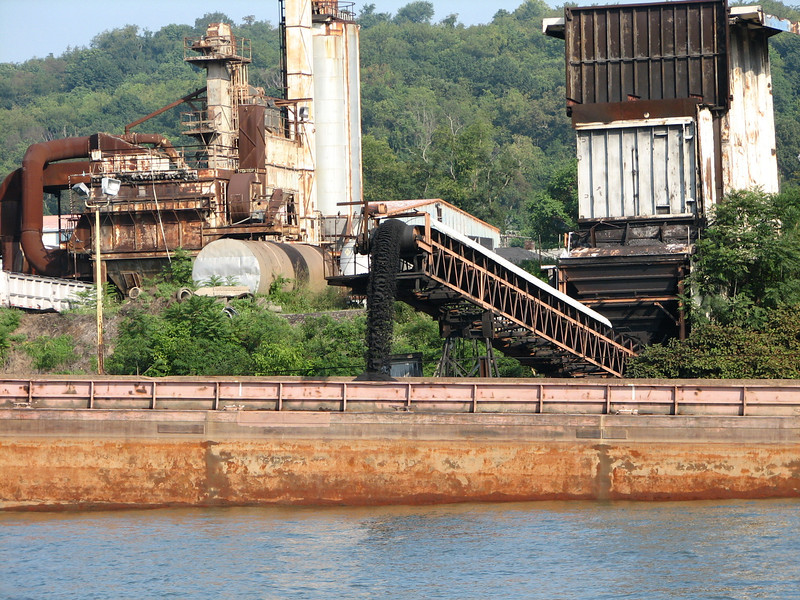 Here is one way to load coal into a barge.