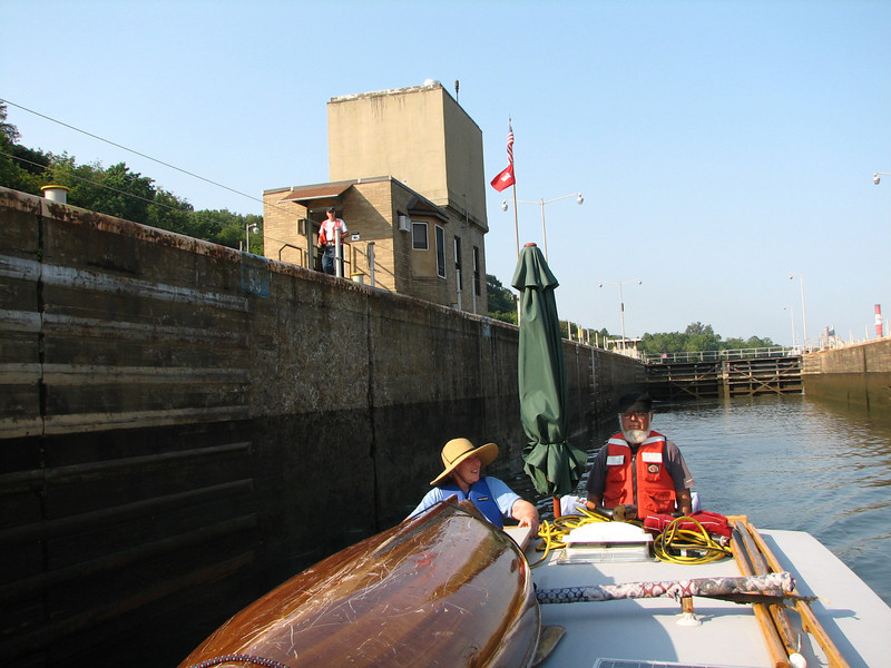 Leaving lock 3 on the Monongahela.  These locks are much larger than what we are accustomed to (i.e., 110 feet wide instead of 40 feet).  Instead of holding on to vertical cables, we hand a long line to the attendant who hooks the center of it above. We hold each end from the bow and stern and let out the line as we descend.