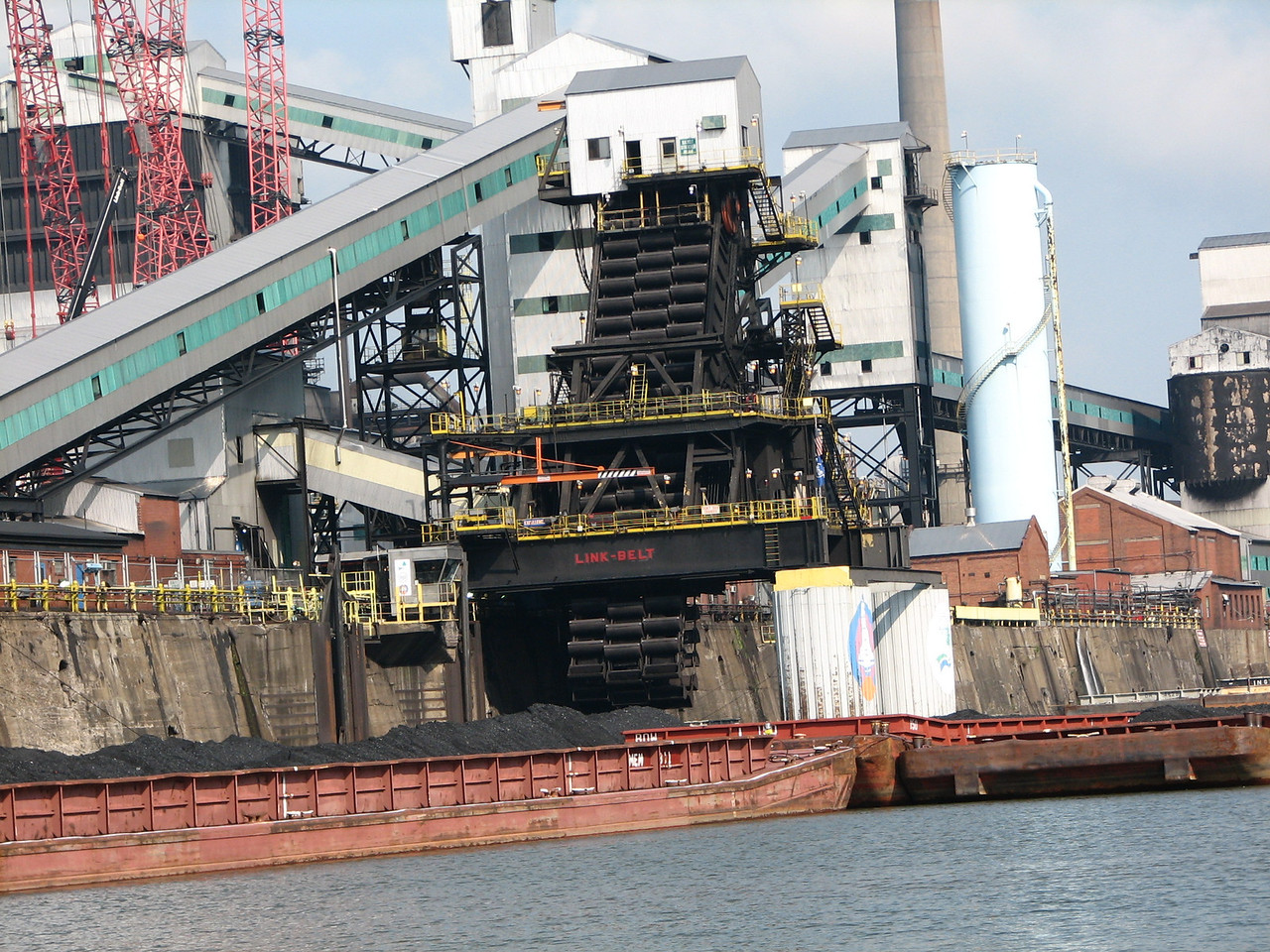 Here is one way to unload a coal barge. This large, movable belt of scoopers is three scoopers wide.