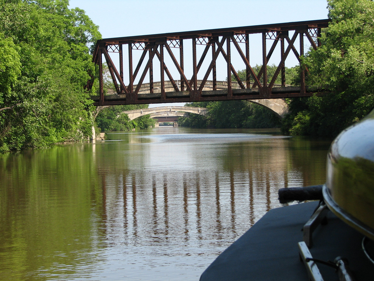 An old railroad bridge and a series of auto bridges where a river intersects the canal in Rochester.