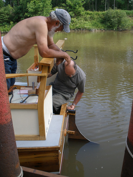 Bolting the rudder in place.