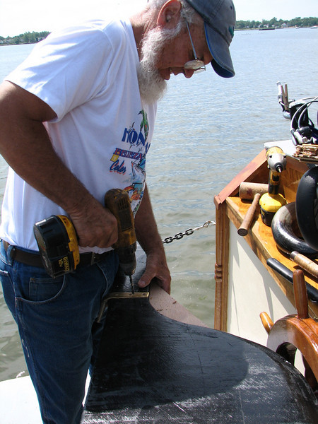 Lynn replaces the pinions to the back-up rudder.