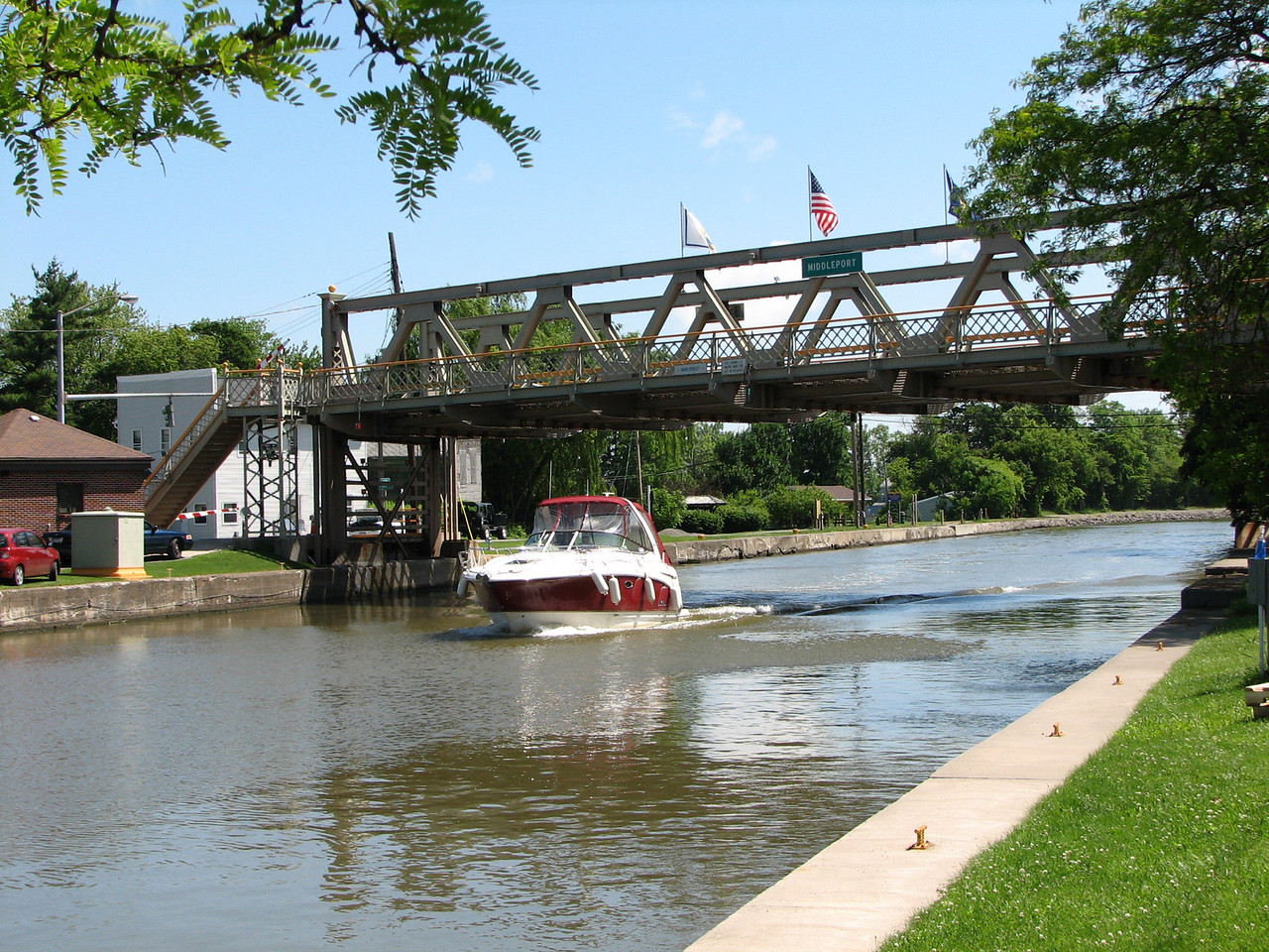 Generally in towns, the canal is very close to street level.  Therefore, lift bridges are needed to let the boats through.  The boater calls the bridge tender on channel 13 and requests a lift.  Usually by the time the boat approaches, the traffic gates are down and the bridge is nearly up.