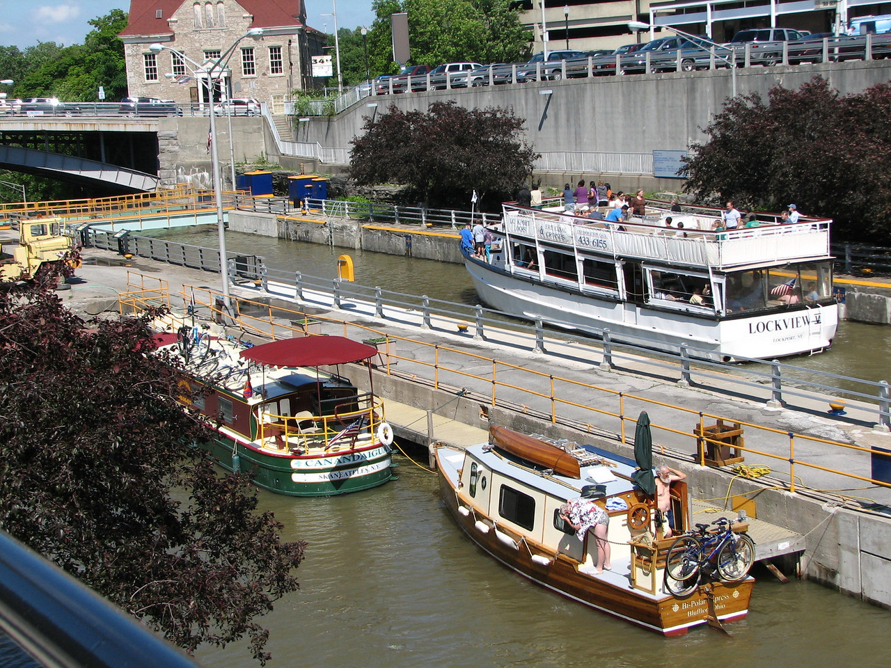 """The BPE tied up behind a rented """"packet boat"""" and a cruise boat in the upper lock basin at Lockport."""