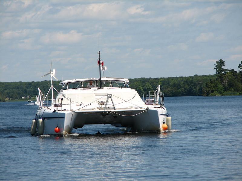 A huge cataraman.  Kayaks, get out of the way!!!