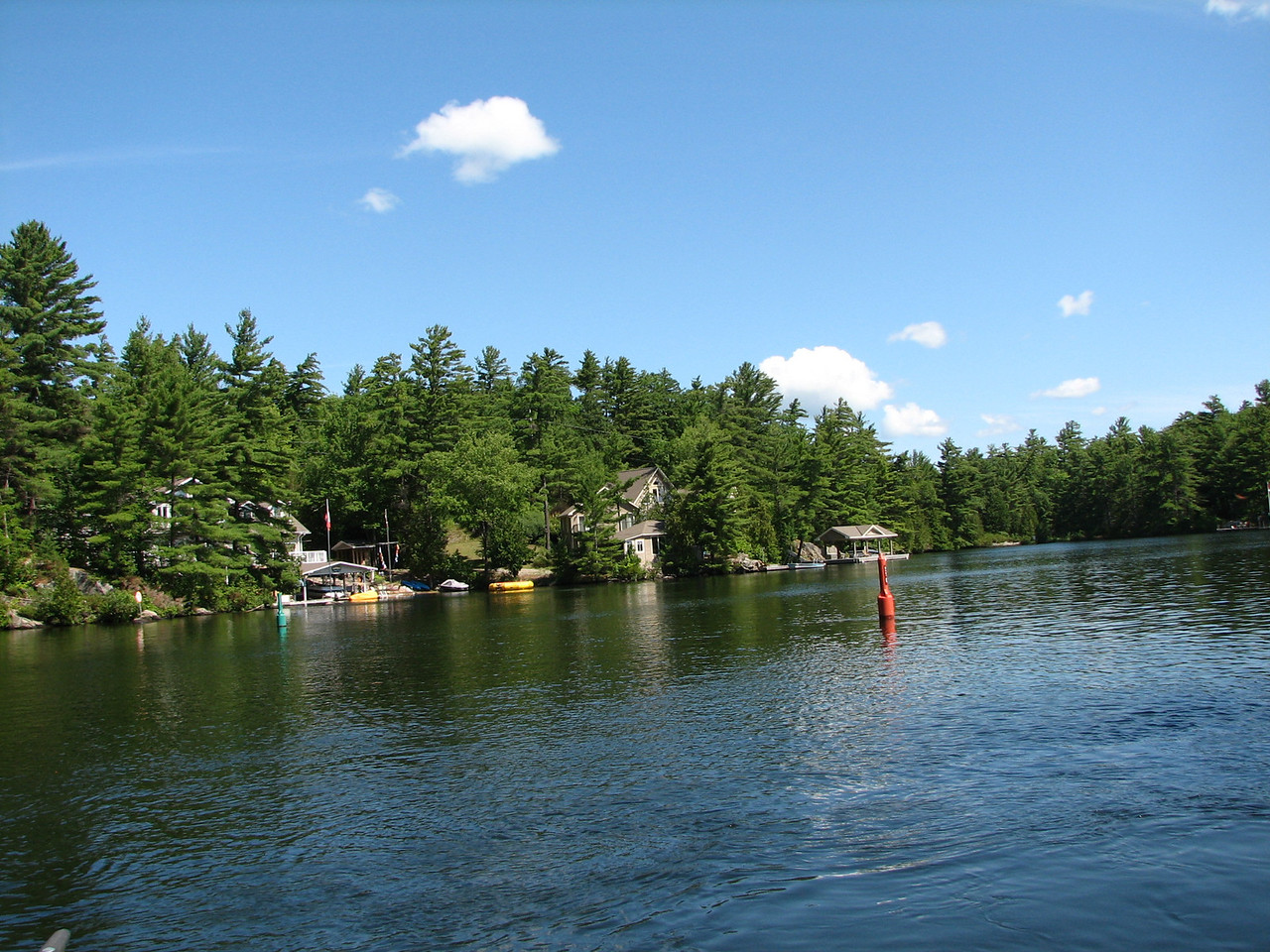"Navigate between the green and red buoys to stay in the channel.  Some lakes are shallow and stumps and logs abound.  When going upstream, remember, ""Red, right, returning."""