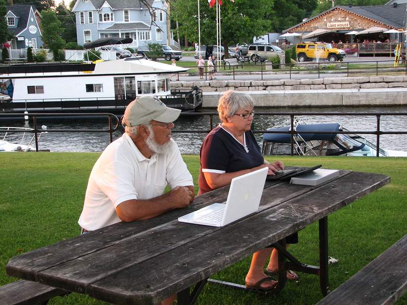 We are spending the night at tthhis lock.  It is broken and no one can lock through.  The workmen and divers worked on it frantically into the night.  Elaine and Lynn tend to business on a grassy park overlooking the lock.