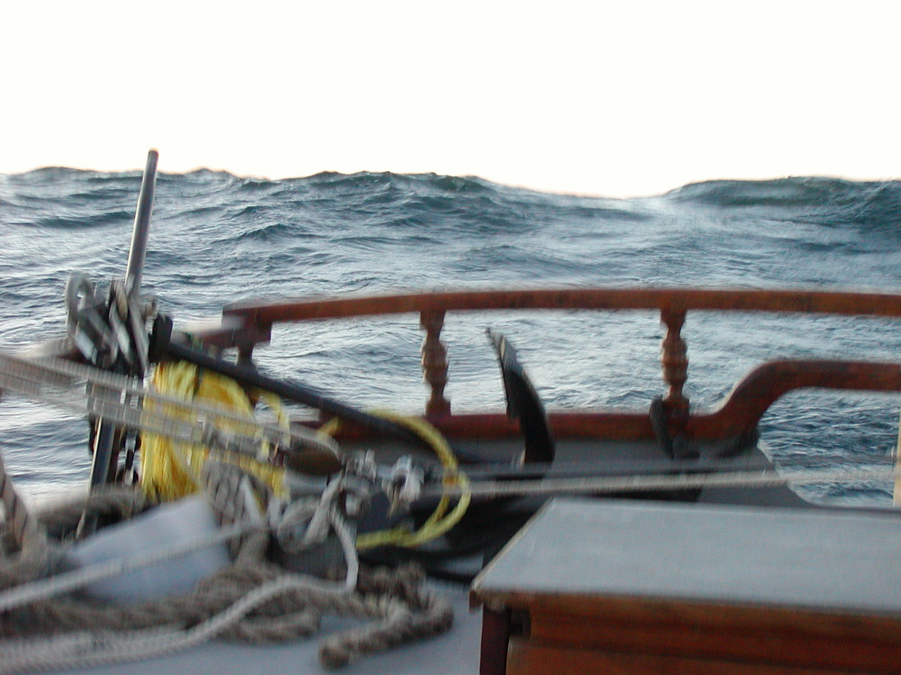 The helmsman at the tiller faces the bow. Although he cannot see them, he can hear the larger swells breaking on themselves as they approach behind us. If the boat drifts too far to the left or right relative to the waves, it can be rolled over. <br /> <br /> The swells in this picture are about eye height. We observed that the heaviest swells seemed to come in sets of three. A few of the very largest swells coming after dark and in the moonlight appeared to be 16 to 18 feet high from the crest of the wave to the trough. <br /> <br /> By 11:00 the wind had not let up and it was clear we needed to find shelter.  The relentless swells required constant vigilence from the helmsman. The nearest port was twenty miles away, which meant another three hours of sailing into the moonbeams. At 12:30 I told Lynn I had only a 90 minute supply of adrenalin left in me.